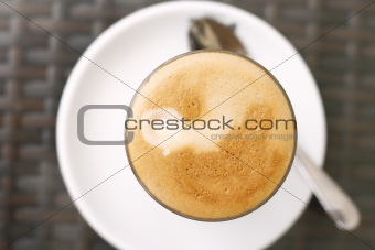 Top down view of a latte in a glass.