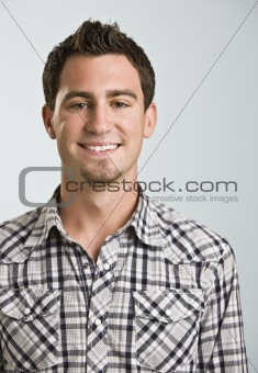Attractive Young Man Smiling at Camera