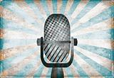 Retro microphone against vintage stylized background
