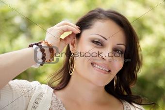 Attractive Hispanic Woman Portrait in the Park.