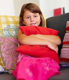 Portrait of a sweet little girl holding a pillow