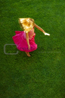 Top view of a little girl in a playful mood