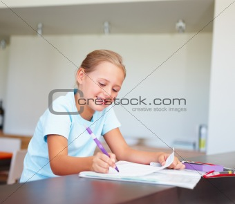 Intelligent little girl doing her homework