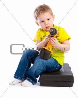Boy with electric screwdriver