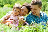 Mom, dad and baby in grass
