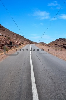 on an empty road up the mountain pass