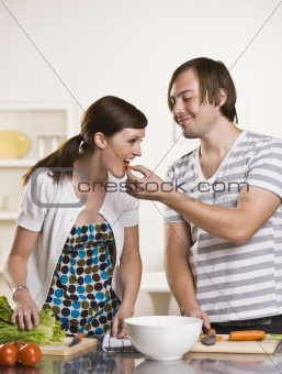 Attractive man feeding woman