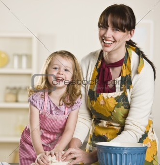 Mom and daughter making bread