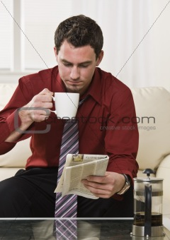 Attractive man drinking coffee