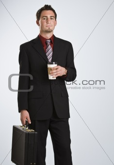 Attractive man with coffee and briefcase