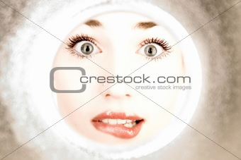 woman looks through a pipe
