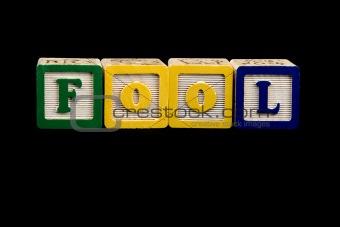 Fool in block letters