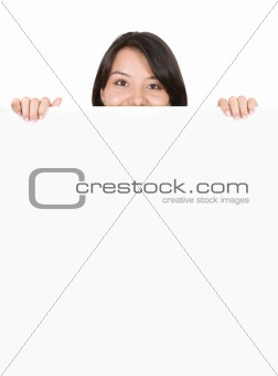 beautiful girl looking over white card