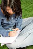 beautiful student working outdoors