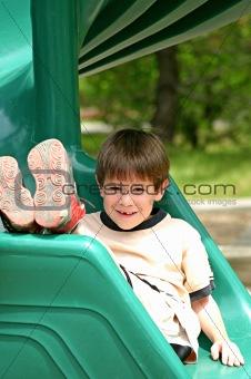 Boy on Green Slide