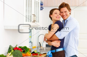 Young couple in their kitchen