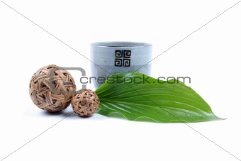 Pottery cup and green leaf