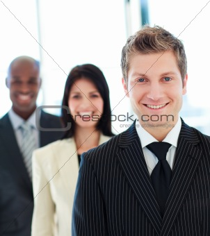 Smiling businessman in front of his team
