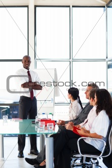 Attractive businessman with folded arms  in a meeting