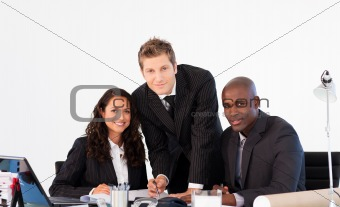 Business people smiling to the camera in a meeting