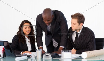 African businessman talking to his team