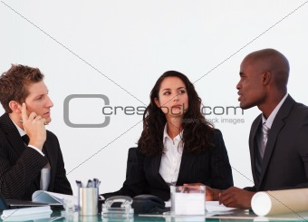 Three business people interacting in a meeting