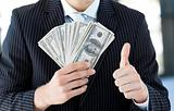 Businessman showing dollars with thumbs up