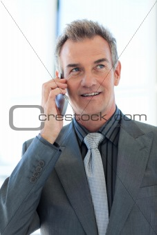 Senior businessman talking on phone