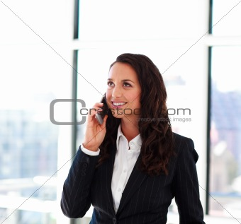 Attractive businesswoman talking on phone