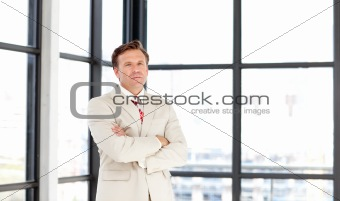 Business leader with folded arms looking at the camera