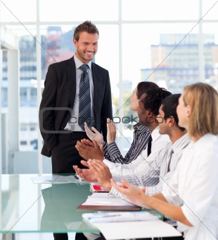 Business team applauding his colleague