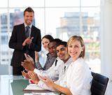 Senior leadership applauding in a meeting
