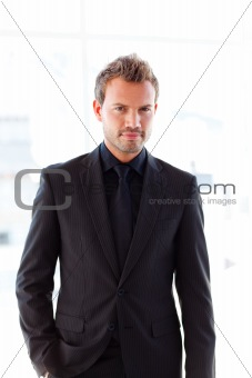 Attractive businessman looking at the camera