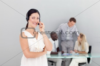Beautiful businesswoman with a headset on