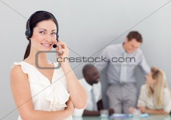 Attractive businesswoman talking on a headset