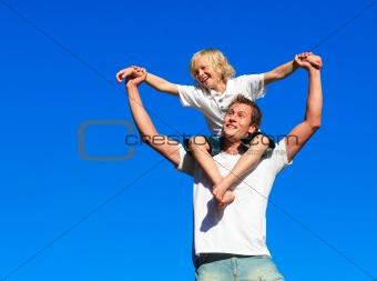 Boy giving kid a piggyback ride