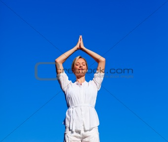Attractive woman practising meditation