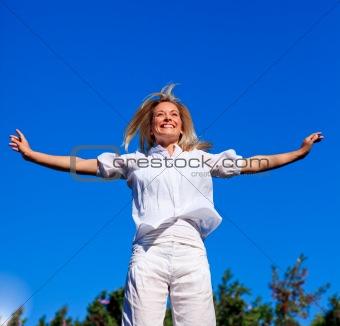 Carefree young woman enjoying life