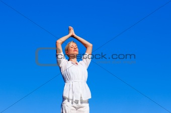 Attractive woman practising yoga
