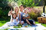Family picnicing in garden