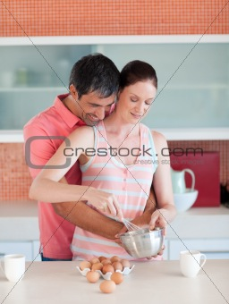 Attractive couple cooking together