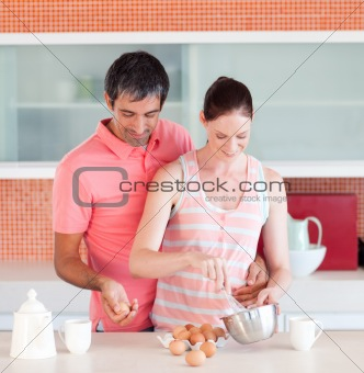 Attractive lovers cooking at home