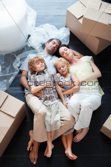 Beautiful family sleeping on the floor