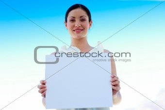 Businesswoman holding a blank board