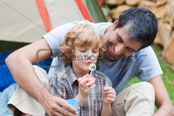 Father and son having fun with bubbles