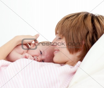 Beautiful patient with newborn baby in bed