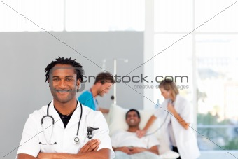 African doctor with his colleagues in the background with copy-s