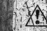 peeled warning sign