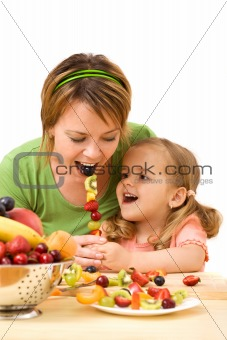 Little girl feeding her mother