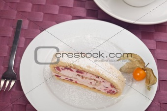 slice of a jelly roll cake on a white plate